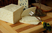 Home cheese, a slice of cheese on a fork and cheese — Стоковое фото