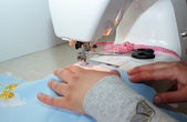 Female hands working on the sewing machine — Stock Photo