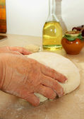 Female hands kneading dough — Stock Photo