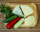 Cheese, homemade cheese and vegetables, top view — Stock Photo