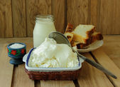 Cottage cheese, sour cream and fresh bread for breakfast — Stock Photo