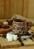 Cup of coffee and spices — Stock Photo