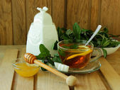 Cup of tea with lemon and mint and honey jar — Stok fotoğraf