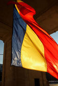 Waving flag tricolor under the Arch of Victory , lit by the setting sun, Chisinau, Moldova, 10 June 2014 — Stock Photo