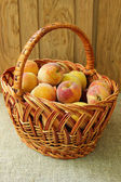 Full basket with ripe peaches — Stock Photo