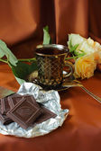 Cup of coffee, roses and chocolate bar — Stock Photo