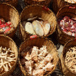 Постер, плакат: Pomorie Bulgaria July 27 2014 Souvenirs seashells lying in baskets