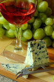 Cheese, a glass of wine and a bunch of grapes — 图库照片