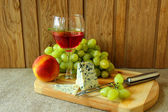 Still-life with a glass of rose wine, cheese and fruit — Stok fotoğraf