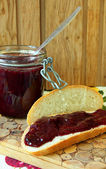 Bread with jam and a jar of jam — Stock Photo
