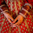 Indian Bride's hands wearing bangles decorated with beautiful he — Stock Photo