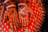 Beautiful Henna and bangles on bride's hands. — Stock Photo