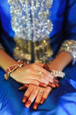 Bride's hand with diamond ring, wearing a blue wedding dress — Stock Photo