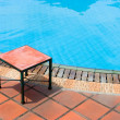 Bench table by the pool — Stock Photo