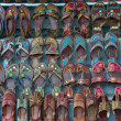 Стоковое фото: Rows of shoes at Indistall