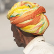 Man in orange and yellow turban — Stock Photo