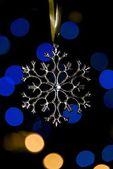 Xmas tree snowflake with bokeh lights — Stock Photo