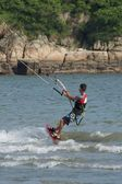 Male kite surfer doing a little jump — Stock Photo