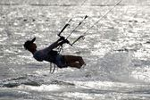 Male kite surfer leaning back almost horizontally — Stock Photo