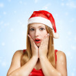 Young woman in santa hat surprised — Foto Stock