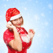 Woman in new year or christmas suit smiling on background with s — Stock Photo
