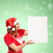 Woman with christmas card on snowfall background — Stock Photo