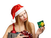 Young woman in santa hat with christmas attributes and little gi — Stockfoto