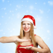 Woman in santa claus hat holding something in hands — Stock Photo
