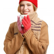 Smiling woman in winter clothing with cup — Stock Photo