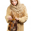 Young woman in warm clothing with knitted bag — Stock Photo #36359715