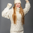 Smiling woman in warm clothing in dancing pose — Stock Photo