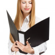 Surprised young business woman with black folder on white backgr — Stock Photo