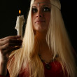 Beautiful blonde woman with candle in hand — Stock Photo