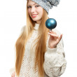 Smiling woman in winter clothing with blue ball — Stock Photo
