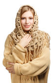 Smiling woman in warm comforter — Stock Photo