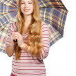 Smiling womwith chequered umbrella — Stock Photo #37001313
