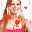 Smiling woman with designer red and pink paper valentine hearts — Stock Photo #37001321