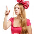 Young surprised woman with big pink bow — Stock Photo