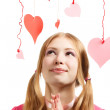 Smiling woman with designer red and pink paper valentine hearts — Stock Photo