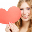 Beautiful young smiling woman with red paper valentine heart — Stock Photo