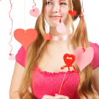Smiling woman with designer red and pink paper valentine hearts — Stock Photo #37689781