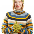 Beautiful young smiling woman in colored striped sweater — Stock Photo