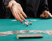 Man throwing dice on a gambling table — Stock Photo