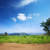 View of Crimean mountains with rural road and grass — Foto Stock