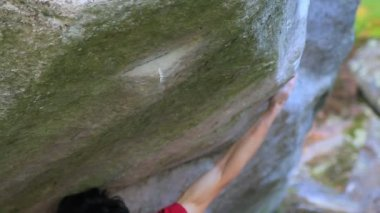 Bouldering in Fontainebleau - close up of a hand catching an edge — Stock Video