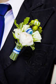 Posed groom with rose button hole. — Stock Photo