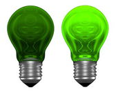 Green light bulbs, one glowing, another not — Stock Photo
