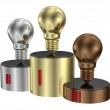 Golden, silver and bronze light bulbs on cylindrical pedestal of same metals — Stock Photo