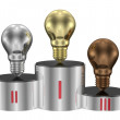 Stock Photo: Golden, silver and bronze light bulbs on cylindrical pedestal. Front view