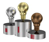 Golden, silver and bronze light bulbs on cylindrical pedestal — Stock Photo